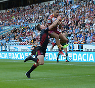 Darnell McIntosh of Huddersfield Giants out leaps Tom Davies of Wigan Warriors to score during the Betfred Super League match at the John Smiths Stadium, Huddersfield<br /> Picture by Richard Land/Focus Images Ltd +44 7713 507003<br /> 12/07/2018