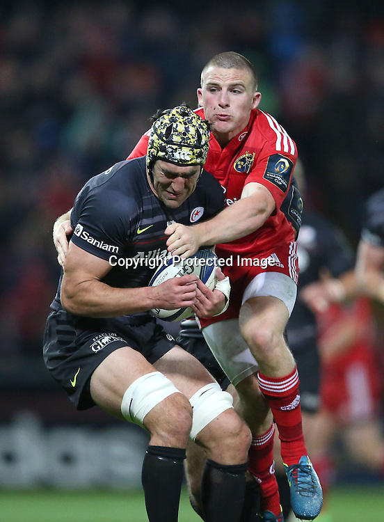 European Rugby Champions Cup Round 2, Thomond Park, Limerick 24/10/2014<br /> Munster vs Saracens<br /> Saracens&rsquo; Kelly Brown is tackled by Munster&rsquo;s Andrew Conway <br /> Mandatory Credit &copy;INPHO/Billy Stickland