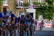 Cyclists peloton speeds through Hampton Court in southwest London compete for the 250km mens' road race on the first day of competition of the London 2012 Olympics. Starting from central London and passing the capital's famous landmarks before heading out into rural England to the gruelling Box Hill in the county of Surrey. Local southwest Londoners lined the route hoping for British favourite Mark Cavendish to win Team GB first medal but were eventually disappointed when Kazakhstan's Alexandre Vinokourov eventually won gold.