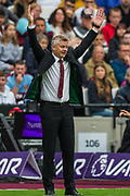 Ole Gunnar Solskjaer, Manager of Manchester United throws his arms in the air during the Premier League match between West Ham United and Manchester United at the London Stadium, London, England on 22 September 2019.