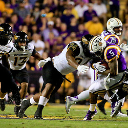 Oct 15, 2016; Baton Rouge, LA, USA;  Southern Miss Golden Eagles defensive lineman Dylan Bradley (94) and linebacker D'Nerius Antoine (12) tackle LSU Tigers running back Derrius Guice (5) during the first half of a game at Tiger Stadium. Mandatory Credit: Derick E. Hingle-USA TODAY Sports