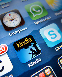 Close-up of screen of iPhone 4G smart phone showing Amazon Kindle ebook app