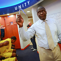 ANN ARBOR, MICHIGAN -- February 5, 2013 -- University of Michigan assistant coach Bacari Alexander shows off a nutcracker during a pre-game speech on game day against rival Ohio State University in Ann Arbor, Michigan.  The Wolverines won 76-74 in overtime.   (PHOTO / CHIP LITHERLAND)