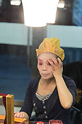Traditional Chinese actress, applies makeup before a performance in a Chinese theatre. Photographed in Chengdu, Sichuan, China