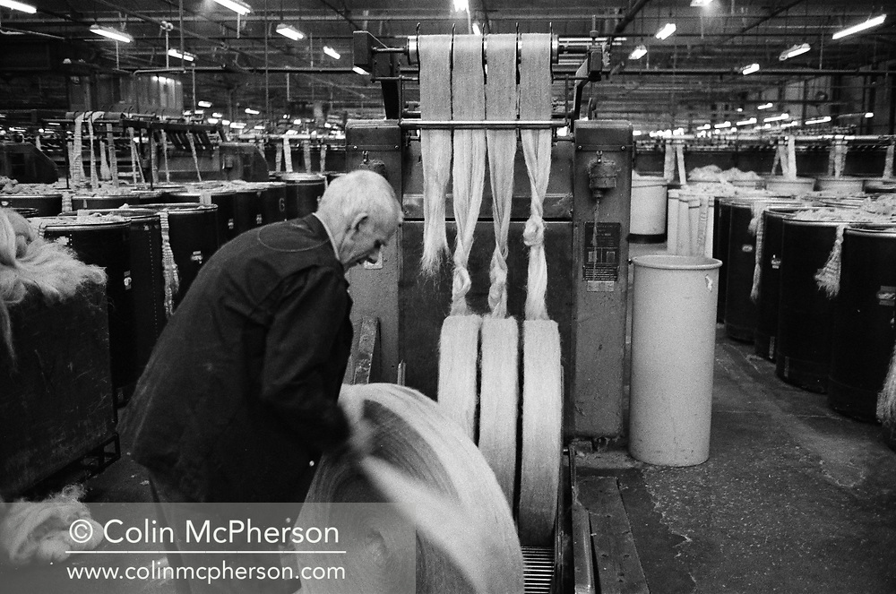 A worker with circular rolls of jute at Tay Spinners mill in Dundee, Scotland. This factory was the last jute spinning mill in Europe when it closed for the final time in 1998. The city of Dundee had been famous throughout history for the three 'Js' - jute, jam and journalism.