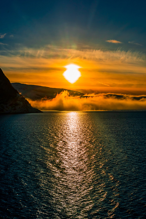 Sea fog along the Arctic coastline of Northern Norway, between Finnsnes and Tromso.