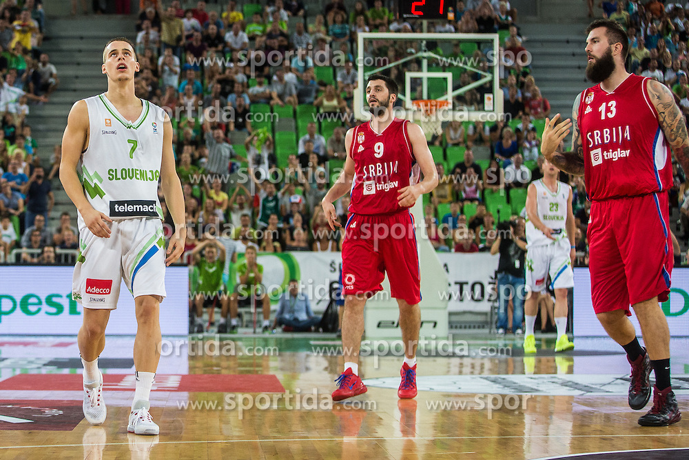 Klemen Prepelic of Slovenia and Markovic & Raduljica of Serbia during friendly basketball match between National teams of Slovenia and Serbia in arena Stozice, on August 23 in Ljubljana, Slovenia. Photo by Grega Valancic / Sportida August 27, 2015