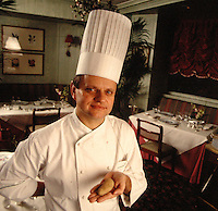 Chef Joel Robuchon with a potato (he became famous for his mashed potatoes) .Restaurant Jamin, Paris, France.