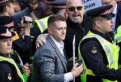 © Licensed to London News Pictures . 27/09/2018. London, UK. Former EDL leader Tommy Robinson (C) (real name Stephen Yaxley-Lennon )  arrives at The Old Bailey for a retrial for Contempt of Court following his actions outside Leeds Crown Court in May 2018 . Robinson was already serving a suspended sentence for the same offence when convicted in May and served time in jail as a consequence , but the newer conviction was quashed by the Court of Appeal and a retrial ordered . Photo credit: Peter Macdiarmid/LNP
