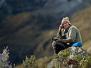 Cesar Roca near Chopicalqui Base Camp.  He is wearing a traditional chullo, a woolen cap with earflaps, decorated with geometric motifs.