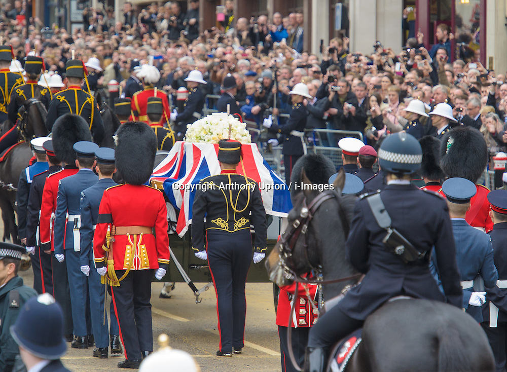 Former British Prime Minister Margaret Thatcher's cortege passes along Fleet Street watched by members of the public on it's way to St. Paul's Cathedral, London, UK, Wednesday 17 April, 2013, Photo by: Anthony Upton / i-Images