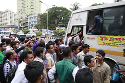 May 29, 2017 - Dhaka, Bangladesh - Bangladeshi people try to ride in of an overcrowded bus to travel home, as others wait for transport ahead of Iftar, in Dhaka, Bangladesh, May 29, 2017 (Credit Image: © Suvra Kanti Das via ZUMA Wire)