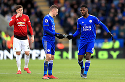 Leicester City's Kelechi Iheanacho (right) hands over a note from Leicester City manager Claude Puel to Jamie Vardy during the Premier League match at the King Power Stadium, Leicester.