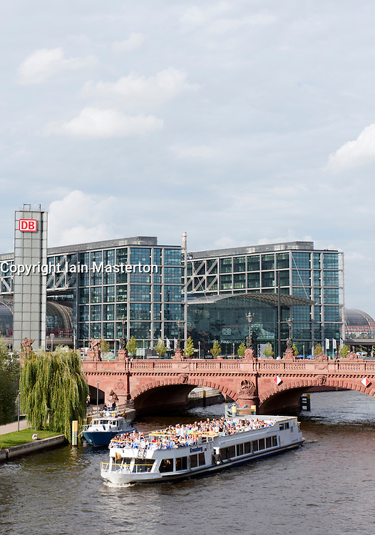 View of tourist river boat  on Spree River with main railway station to rear in Berlin Germany
