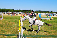 Megan and Poppy participating in stadium jumping at the Inavale horse trials