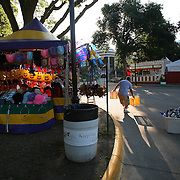 FAIR - DES MOINES, AUG. 13 -- An hour before fairgoers arrived, John Beaver, with Event Toys, began to set up his stand Sunday.