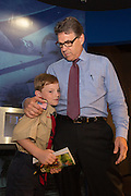 Former Texas Governor and GOP presidential hopeful Rick Perry hugs a young Eagle Scout before holding a town hall aboard the USS Yorktown in Mount Pleasant, South Carolina.