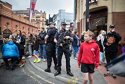 © Licensed to London News Pictures . 19/05/2019. Manchester, UK. Armed police provide security on Portland Street . The Great Manchester Run takes place in Manchester City Centre , starting at Portland Street . Photo credit : Joel Goodman/LNP