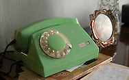 An old, rotary dial telephone sits still in use in a home in Anzhero-Sudzhensk, Russia. (Photo by Phelan M. Ebenhack)
