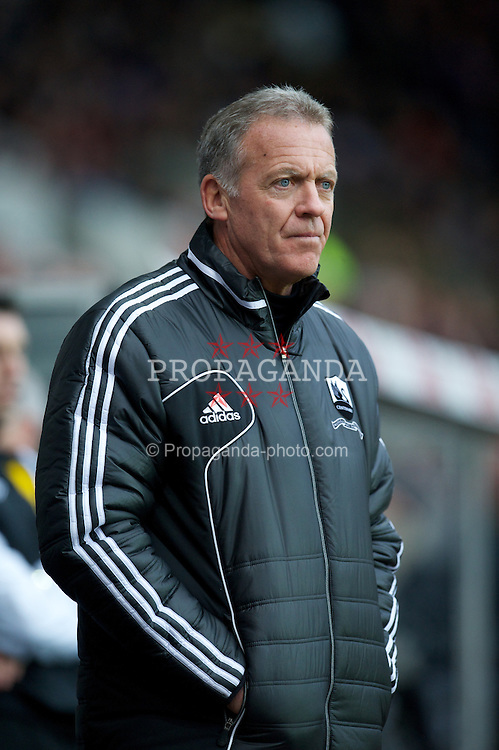 SWANSEA, WALES - Sunday, December 23, 2012: Swansea City's assistant manager Alan Curtis during the Premiership match against Manchester United at the Liberty Stadium. (Pic by David Rawcliffe/Propaganda)