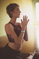 Woman practicing yoga.