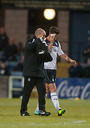 Falkirk's Kieran Duffie goes of injured with a cut eye.<br /> Dundee 1 v 1 Falkirk, Scottish Championship game at Dundee's home ground Dens Park.<br /> &copy;Michael Schofield.