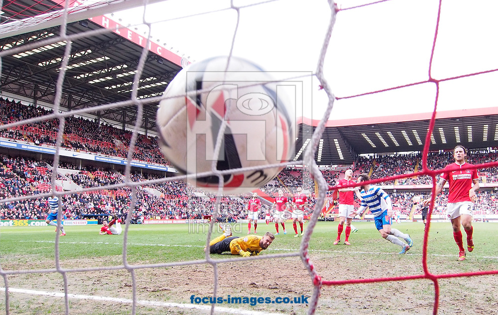 Daniel Williams of Reading (L) scores their first goal past Ben Hamer of Charlton Athletic during the Sky Bet Championship match at The Valley, London<br /> Picture by Andrew Tobin/Focus Images Ltd +44 7710 761829<br /> 05/04/2014