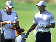 Tiger Woods and his caddy Joe LaCava enjoy a lighter moment on the 16th fairway. The Chevron World Challenge put Sherwood Country Club on display during the Pro-am round. Thousand Oaks, CA 11/30/2011(John McCoy/Staff Photographer)