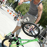 Angel Gabat from Skate Park Association Street Team performs stunts on a BMX during Santa Monica Public Library's bicycles and cycling iCycle festival on Saturday, May 22, 2010.