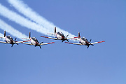 Israeli Air force Flight Academy Beechcraft T-6A Texan II Aerobatics team in flight.