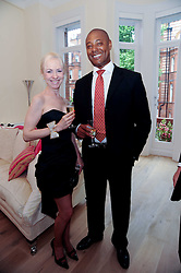 LADY BIENVENIDA BUCK and PERRY DOUGLIN at a reception to celebrate the repairs on the Queen Elizabeth Gate in Hyde Park after it's successful repair following damaged sustained in a traffic accident in early 2010.  The party was held at 35 Sloane Gardens, London on 7th June 2010.
