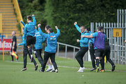 The Salford City bench erupts onto the pitch as they see their side score their first goal and get the equaliser in extra time. 1-1 (2-2) during the Vanarama National League North match between FC Halifax Town and Salford City at the Shay, Halifax, United Kingdom on 7 May 2017. Photo by Mark P Doherty.