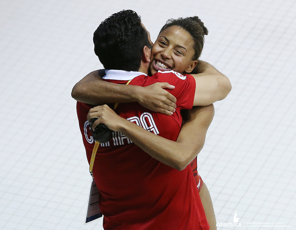 TORONTO, ON - JULY 12:  Jennifer Abel of Canada hugs her coach after winning Gold in the Women's 3m Springboard Final during the Toronto 2015 Pan Am Games at the CIBC Aquatic Centre on July 12, 2015 in Toronto, Ontario, Canada.  (Photo by Vaughn Ridley/Canada Diving)