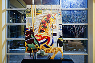 Garden City, New York, USA. March 9, 2019.  After the Unveiling Ceremony of painting of closeup of Nunley's Carousel lead horse, artist Michael White's mural (approximately 7 feet high by 5 feet wide) is on display for the rest of the event in the carousel pavilion, on Museum Row on Long Island.