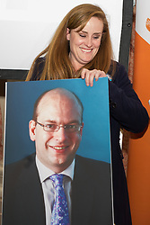 © Licensed to London News Pictures . 18/11/2014 . Kent , UK . Kelly Tolhurst ( Conservative candidate ) leaves the debate and passes behind a cardboard poster of UKIP candidate Mark Reckless , who didn't attend , at a hustings in the Rochester and Strood by-election , held at the Corn Exchange in Rochester , this evening ( 18th November 2014 ) . Photo credit : Joel Goodman/LNP