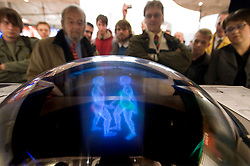 """HANNOVER, GERMANY - MARCH-6-2008 -  The """"bollograph"""" is a truly three-dimensional monitor that takes data from a 3-D application and can skip the usually step of rendering the data and display it in true three dimensions - viewable from all sides. The demo attracted a crowd of fascinated onlookers. The company is Soscho gmbh, located in Bavaria (www.soscho.de) and it's principle founders are inventor Dr. Peter Boll and his partner Christian Lepper. Possible applications include real-time TV broadcast in true 3D, 3D cinema, medical applications, flight control and the list goes on..(Photo © Jock Fistick)"""