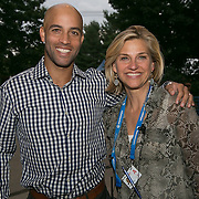 August 22, 2014, New Haven, CT:<br /> James Blake poses for a photograph Tournament Director Anne Worcester on day eight of the 2014 Connecticut Open at the Yale University Tennis Center in New Haven, Connecticut Friday, August 22, 2014.<br /> (Photo by Billie Weiss/Connecticut Open)