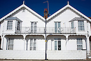 Semi detached wooden weather-boarded white seaside houses, Undercliff Road east, Felixstowe, Suffolk, England