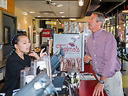 23 SEPTEMBER 2019 - DES MOINES, IOWA: MARK SANFORD, right, the former Republican Governor of South Carolina and six term Congressman from South Carolina, orders lunch to go at Zombie Burger, a Des Moines restaurant, Monday. Sanford is challenging incumbent President Donald Trump for the Republican nomination for the US presidency. Iowa hosts the first event of the presidential selection cycle. The Iowa Caucuses are scheduled for February 3, 2020.         PHOTO BY JACK KURTZ