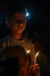 April 28, 2019 - Srinagar, Jammu and Kashmir, India - A Kashmiri Shia protester seen holding candle during a candle light protest in Srinagar..Shia protesters held a candle light vigil in Srinagar against the mass execution of 37 individuals in Saudi Arabia. According to Saudi Press Agency, those executed were accused of ''forming a terrorist cell'' and attacking a security outpost, killing a number of officers. (Credit Image: © Idrees Abbas/SOPA Images via ZUMA Wire)