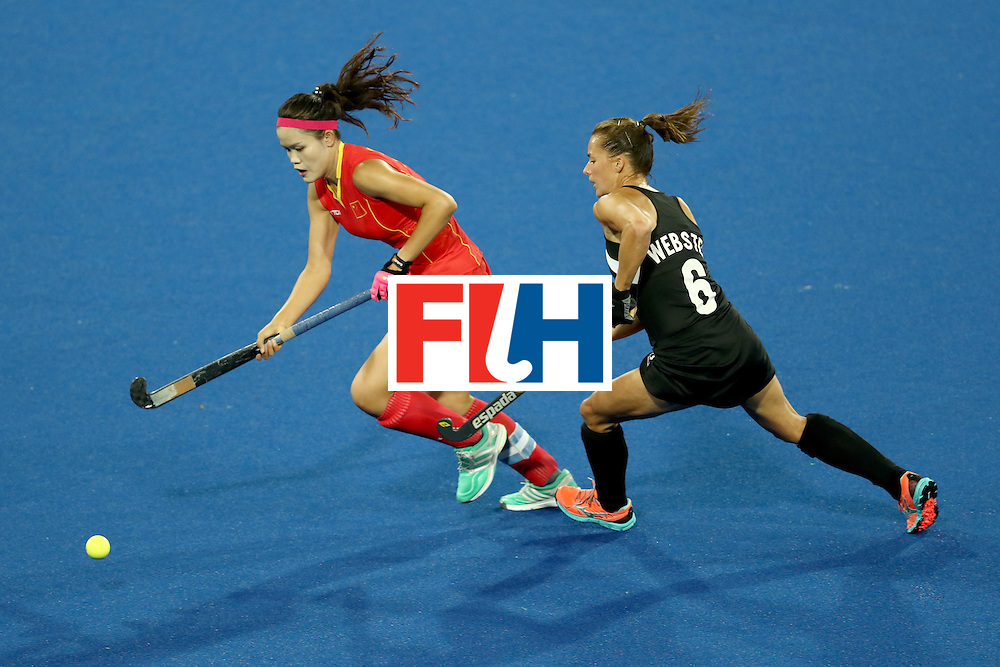 RIO DE JANEIRO, BRAZIL - AUGUST 13:  Petrea Webster of New Zealand and Qiuxia Cui of China compete for the ball  in the Women's Pool A match between the People's Republic of China and New Zealand on Day 8 of the Rio 2016 Olympic Games at the Olympic Hockey Centre on August 13, 2016 in Rio de Janeiro, Brazil.  (Photo by Phil Walter/Getty Images)