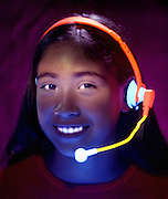 Portrait of a young girl with phone headgear.Black light