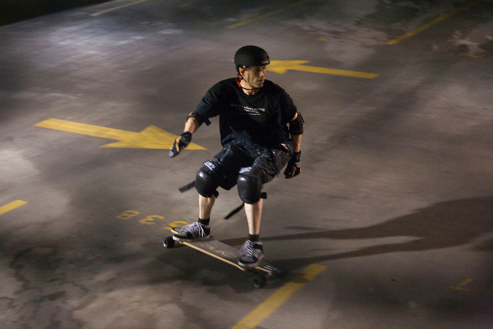 Mike Lippy, 44, joins a half-dozen other skaters at a garage in Fells Point in Baltimore on Wednesday, June 16, 2010.