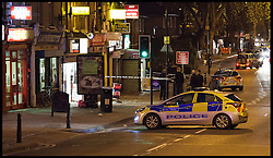 Police officers have closed off  Homerton High street, London,  after an incident, Saturday, 30th November 2013. Picture by Daniel Leal-Olivas / i-Images