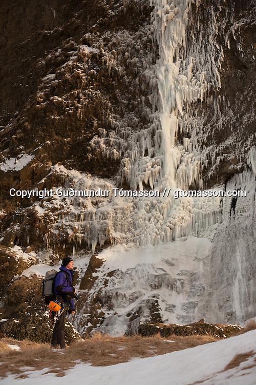 "Róbert Halldórsson under the ice climb ""Bjarta hlíðin"" WI6, Eyjafjöll, southcoast Iceland."