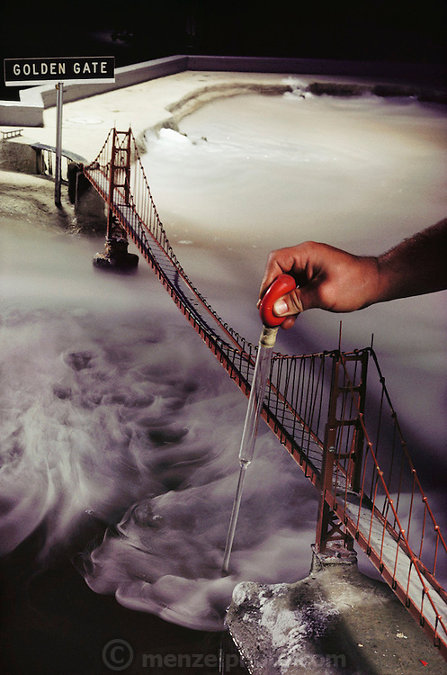 San Francisco Bay model, with the Golden Gate bridge. Sausalito. California. An engineer is taking a water sample.