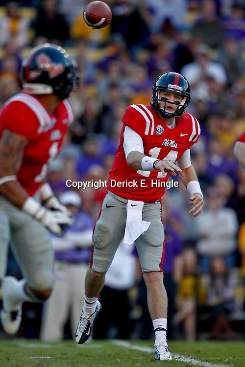 November 17, 2012; Baton Rouge, LA, USA;  Ole Miss Rebels quarterback Bo Wallace (14) throws against the LSU Tigers during the first half of a game at Tiger Stadium.  Mandatory Credit: Derick E. Hingle-US PRESSWIRE