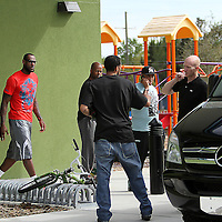 NBA All Star LeBron James leaves after an event at the Boys & Girls Club of Central Florida on Saturday, Feb. 25, 2012 in Orlando, Florida. The LeBron James Family Foundation and Sprite donated sporting equipment and introduced a new baseball diamond, renovated play area and a picnic area.  (AP Photo/Alex Menendez)