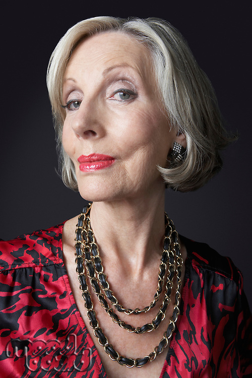 Wealthy Senior Woman wearing necklace