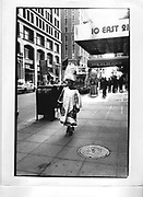 A black woman carries her shopping home on her headStreet scenes of New York in 1993,ONE TIME USE ONLY - DO NOT ARCHIVE  © Copyright Photograph by Dafydd Jones 66 Stockwell Park Rd. London SW9 0DA Tel 020 7733 0108 www.dafjones.com